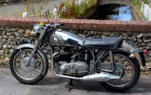 Whilst we admire the surroundings local villagers admire the Norton
