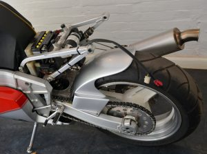 Compact and minimal seat frame with swing arm and eccentric chain adjustment for the 17inch rim