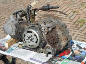 Carb and sprocket look grim but note the CDi pick-up; early moped electronics