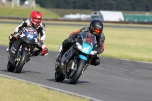 Chris Camps (4, Kawasaki) with Francesco Cavalli (99, Honda) in the EDIasia F400 race