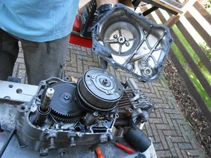 It's all gears and springs as we carefully remove the side cover, even the gasket needs to be saved