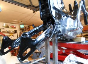 In goes the swing-arm plus shiny motor bit fiddly but we are on a roll now