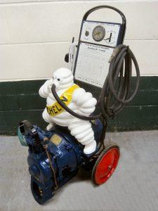 Michelin forecourt compressor 'Bomb' cast Bibendum astride compressor unit