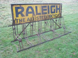 Raleigh original period eight bike rack with original enamel sign