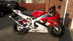 Yamaha 4XV R1 Sporting the Venture soft luggage and rack