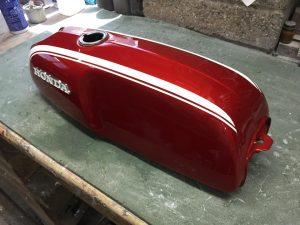 restored Honda SS50 tank