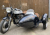 Dating from the 1960s, the Triton cafe racer has been paired with a lightweight Watsonian Prescott. Powered by a Triumph parallel twin motor, sitting in a Norton Featherbed frame